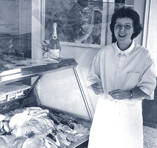 Woman in front of fish counter