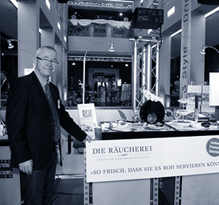 Herr Kunkel an Messestand